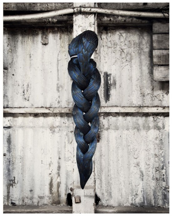 Splice, Kate MccGwire, 2012, Mixed media with magpie feathers and metal ligature, 130 x 30 x 32 cm